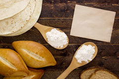 Bakery products flour in a wooden spoon Royalty Free Stock Image