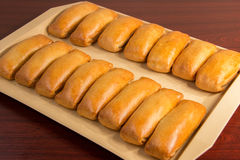 Bakery products. Golden brown cakes, and all Russian belyashi ru Stock Photos