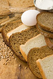 Bakery products and grain on wood Stock Images