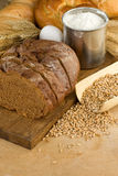 Bakery products and grain on wood Stock Photos