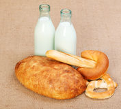Bakery products and milk in glass bottle Royalty Free Stock Photography