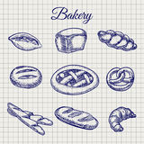 Bakery products on notebook page. Hand drawn bakery products. Vector bread, bun, baguette etc on notebook page background Royalty Free Stock Images