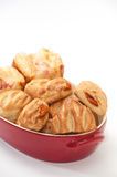 Bakery products in a red bowl Stock Photography