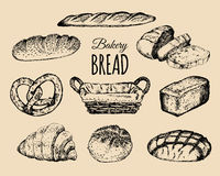 Bakery products set.Bread collection.Hand drawn loafs, croissant,bagel etc illustration with wicker basket.Pastry signs. Bakery products set. Bread collection Royalty Free Stock Images