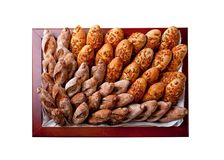 Bakery products in a square basket Royalty Free Stock Images