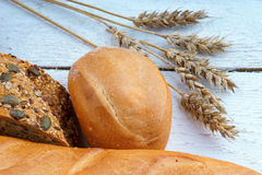 Bakery products and wheat ears Stock Photos