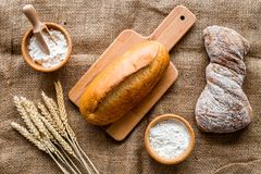 Bakery set with fresh wheaten bread on table rystic background top view Royalty Free Stock Images