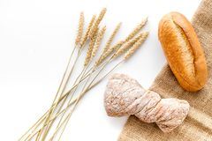 Bakery set with fresh wheaten bread on table white background top view mock up Stock Photos