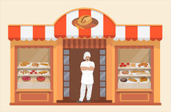 Bakery shop building with bakery products and Baker Royalty Free Stock Images