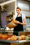 Bakery Shop. Happy Woman Selling Pastry royalty free stock photo