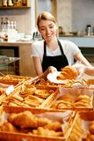 Bakery Shop. Happy Woman Selling Pastry stock images