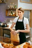 Bakery Shop. Happy Woman Selling Pastry royalty free stock image