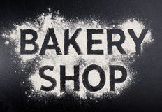 Bakery shop word made of flour. Baking store logo. Royalty Free Stock Photography