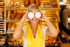 Bakery shopkeeper covers eyes with meringue Royalty Free Stock Photo