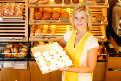 Bakery shopkeeper presents meringue Stock Image