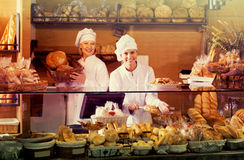 Bakery staff offering bread Royalty Free Stock Image
