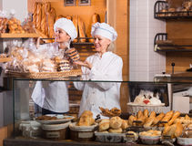 Bakery staff offering bread Stock Photography