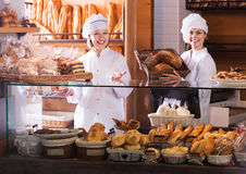 Bakery staff offering bread Stock Photo