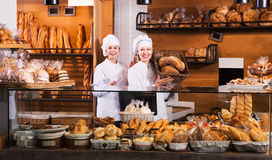 Bakery staff offering bread Royalty Free Stock Images