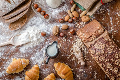 At the bakery, still life with mini Croissants, bread, milk, nuts and flour Stock Photo