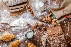 At the bakery, still life with mini Croissants, bread, milk, nuts and flour Royalty Free Stock Image