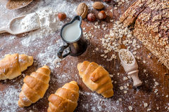 At the bakery, still life with mini Croissants, bread, milk, nuts and flour Stock Photography