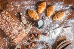 At the bakery, still life with mini Croissants, bread, milk, nuts and flour Stock Image