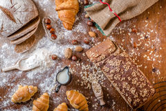 At the bakery, still life with mini Croissants, bread, milk, nuts and flour Stock Photos