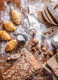 At the bakery, still life with mini Croissants, bread, milk, nuts and flour Royalty Free Stock Images