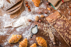 At the bakery, still life with mini Croissants, bread, milk, nuts and flour Royalty Free Stock Photography