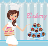 Bakery store - saleswoman serving cakes Stock Images