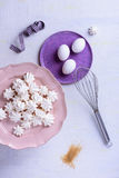 Bakery sweet dessert ingredients. French meringues made of egg whites and sugar. Above view. Stock Images