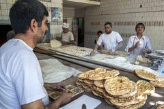 A bakery in Urfa in Turkey. Men busy at work making Turkish flat bread in a bakery in Urfa (Sanliurfa) in south eastern Turkey Royalty Free Stock Photos