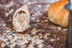 At the bakery, using oat for baking. Bread Stock Photography
