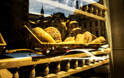 Bakery Window. With a bread basket and city reflection Royalty Free Stock Photography
