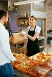 Bakery. Woman Working, Selling Bakery To Male. Bakery. Woman Working, Selling Fresh Bakery To Male Buyer. High Resolution Royalty Free Stock Photos