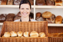 Bakery worker with a basket of rolls Stock Image