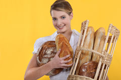Bakery worker holding basket Royalty Free Stock Image