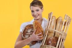 Bakery worker holding basket Royalty Free Stock Image