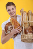 Bakery worker holding basket Royalty Free Stock Photography