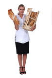Bakery worker holding bread Royalty Free Stock Photography