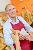 Bakery worker selling bread stock photos