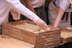 Bakery workers making pastries Royalty Free Stock Images