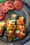 Bakes eggplants with vegetables on the clay plate Royalty Free Stock Images