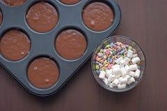 Bakeware on a dark wooden background Stock Photos