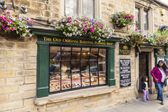 Bakewell, Derbyshire, England - July 19, 2015: The Old Original Bakewell Pudding Shop, Bakewell Derbyshire, England,United Kingdom. The Old Original Bakewell stock photos