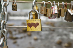 Bakewell, Derbyshire, England, UK - July 19, 2015: Love locks attached to the cable on weir bridge, Bakewell, Derbyshire, England. Stock Photography