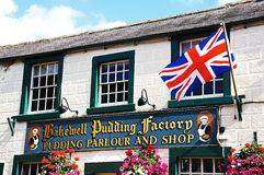 Bakewell Pudding Factory and flag. Royalty Free Stock Photo