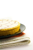 Bakewell Tart. Delicious looking iced bakewell tart on a black plate with a plain background Stock Photos