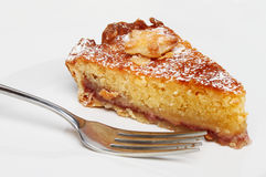 Bakewell tart and fork Stock Image